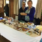 Shirley and Pat admiring the tasty home made cakes