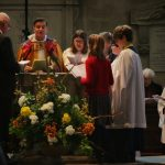 The confirmands are reminded of their baptism