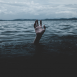 Hand in Water Photo by Ian Espinosa on Unsplash