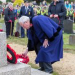 Councilor laying a wreath