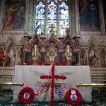 The altar,with clay poppies along the back and hand knitted poppies upon a cross in front. Wreathes from St Mark's and the Royal Air Force, to join those already at the memorial from our service on Friday.