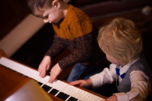 Ethan and Austin may not quite have the skills at the piano just yet, but certainly don't lack for enthusiasm!