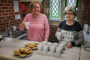Shirley and Maureen offer refreshments to the volunteers!