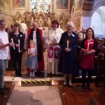 Those being confirmed - from left to right - Oliver, James, Beverley, Susan, Barbara and Alex: with Lauren centre, baptised during the service